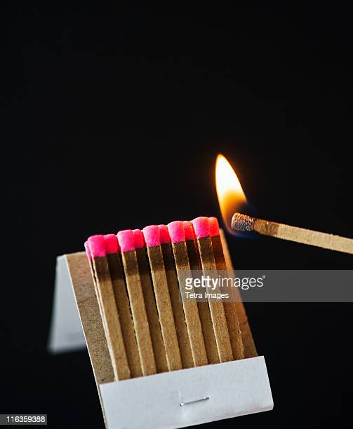 Close up of matches with one burning