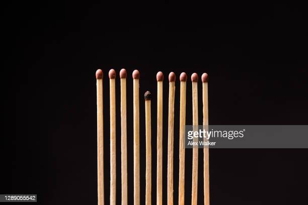 close up of matchsticks against black background - obsessive compulsive disorder stock pictures, royalty-free photos & images