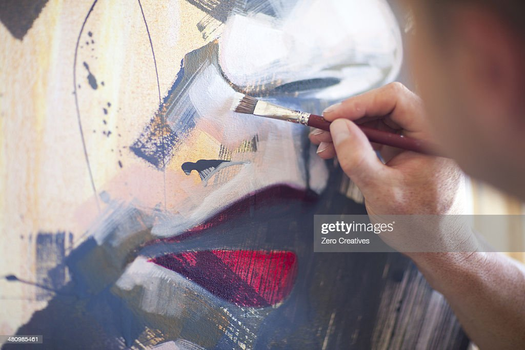 Close up of mature male artist working on canvas : Stock Photo