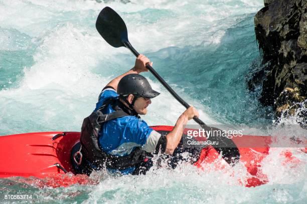 Close Up Of Mature Man Kayaking On White Water's