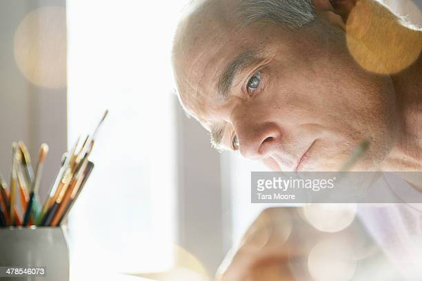 close up of mature man painting