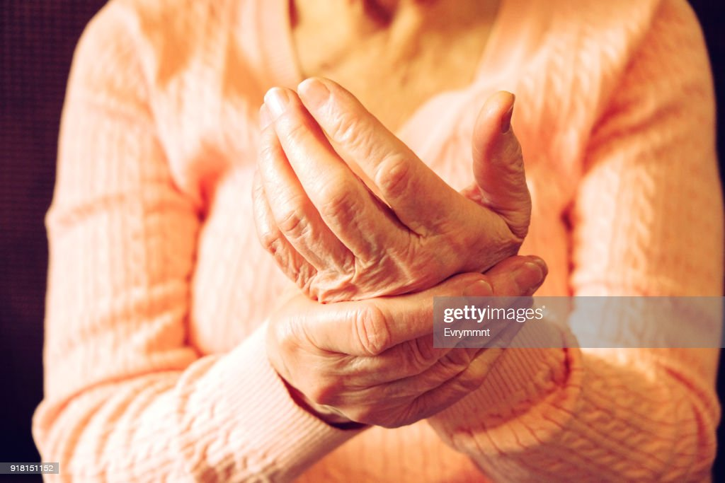Close up of mature womans hands. Health care giving, nursing home. Parental love of grandmother. Old age related diseases. : Stock Photo