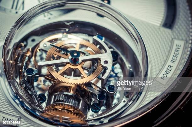 close up of mechanical watch - kleine uhr stock-fotos und bilder