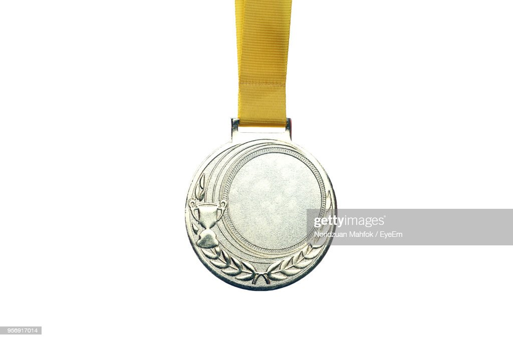Close Up Of Medal Against White Background : Stock Photo
