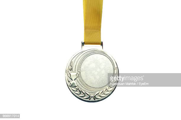 Close Up Of Medal Against White Background