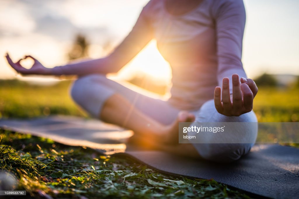 Close up of meditation in park at sunrise. : Stock Photo