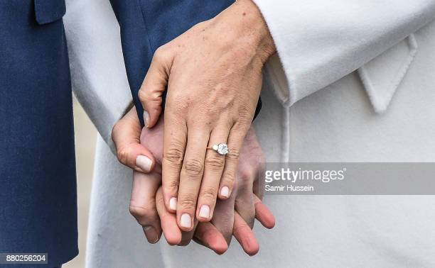 A close up of Meghan Markle's engagement ring during an official photocall to announce the engagement of Prince Harry and actress Meghan Markle at...
