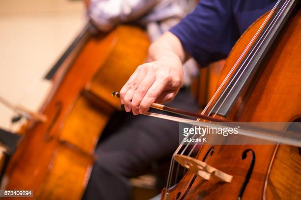 close up of men playing violin cello in concert - classical musician stock pictures, royalty-free photos & images