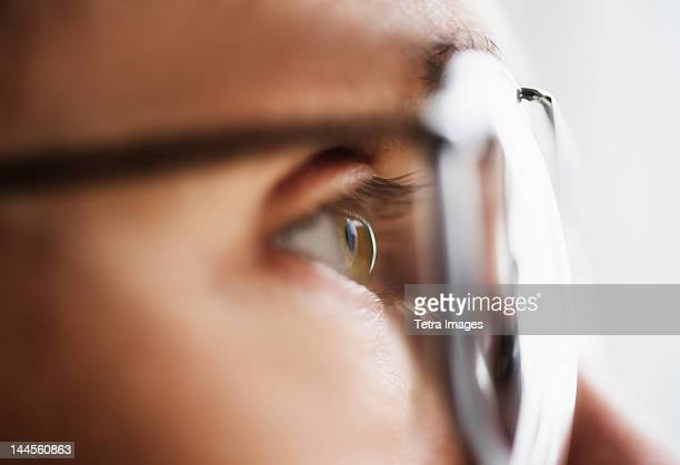 Close up of men's eye looking through glasses