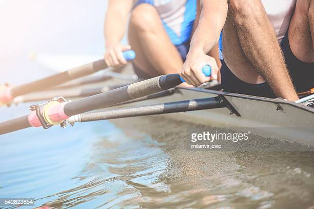 close up of men's rrowing team - will power stock photos and pictures
