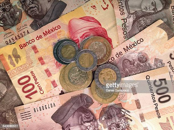 Close up of Mexican Peso banknotes and coins