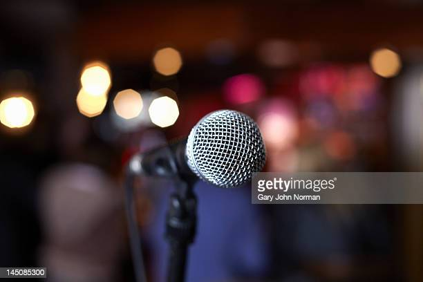 close up of microphone on stage in lights
