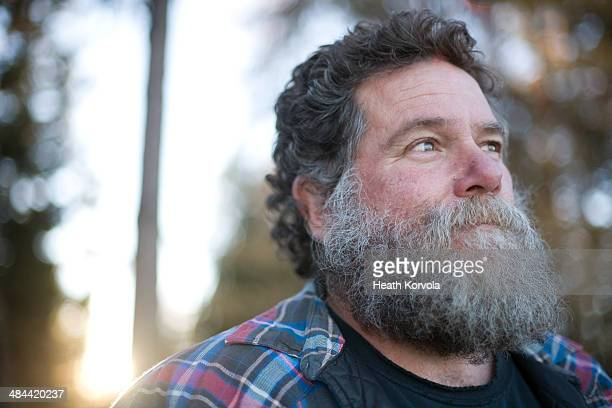 close up of middle age man with large beard. - chubby stock pictures, royalty-free photos & images