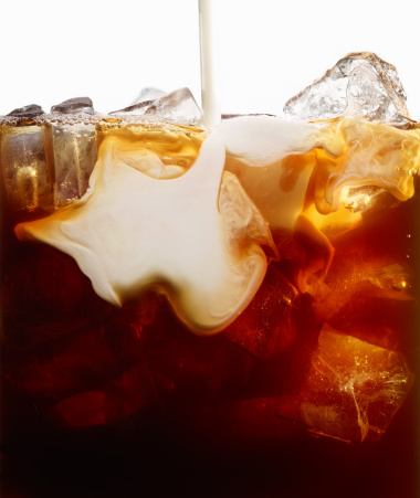 Close Up of Milk Pour into Iced Coffee - gettyimageskorea