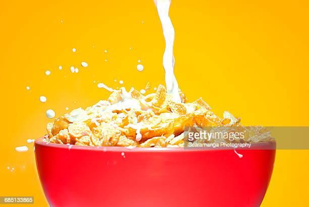 Close up of milk splashing on cereal