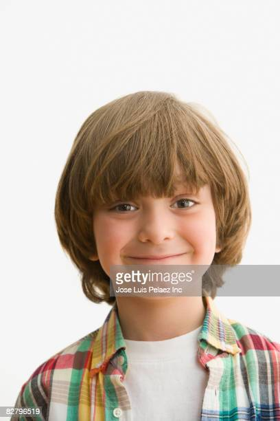 Close up of mixed race boy smiling