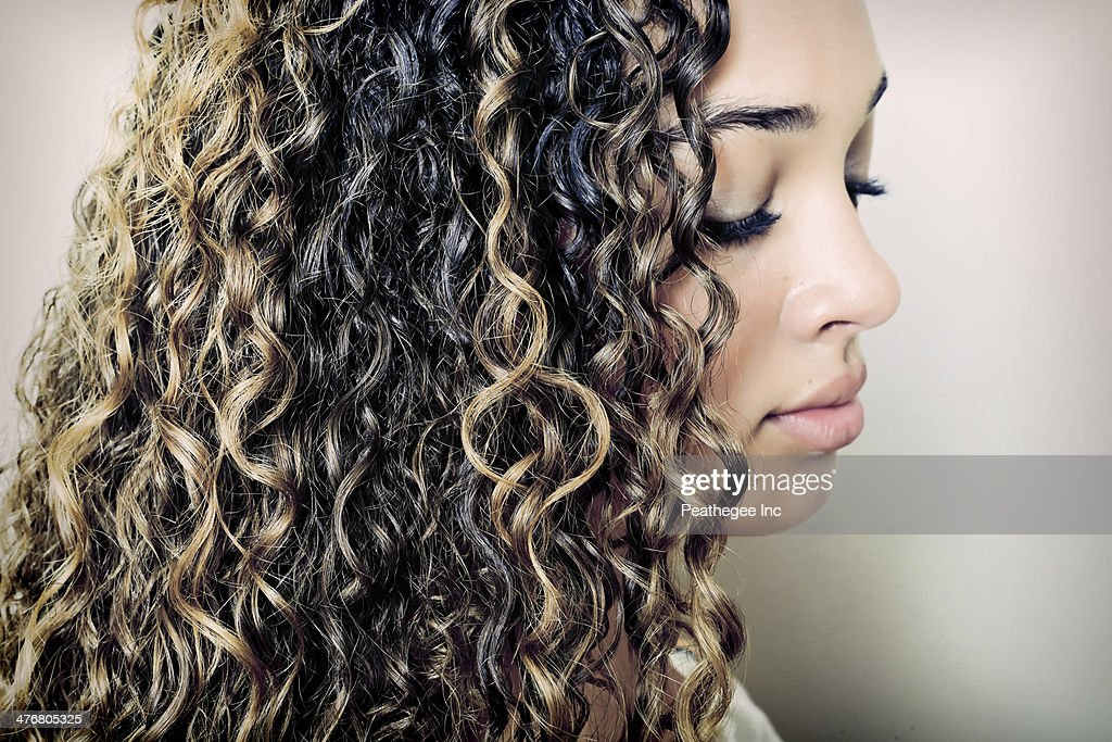 Close up of mixed race girl looking down : Stock Photo