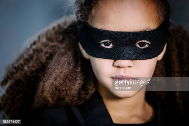 Close up of mixed race girl wearing mask