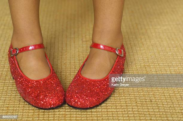 Close up of mixed race girl wearing red shoes