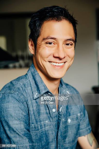 Close up of mixed race man smiling