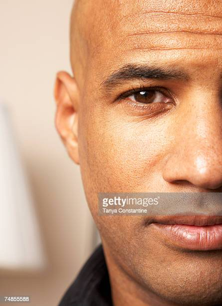 close up of mixed race man's face - completely bald stock photos and pictures