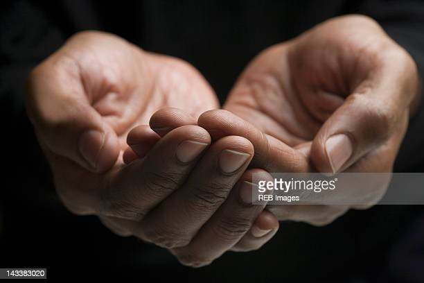 Close up of mixed race man's hands