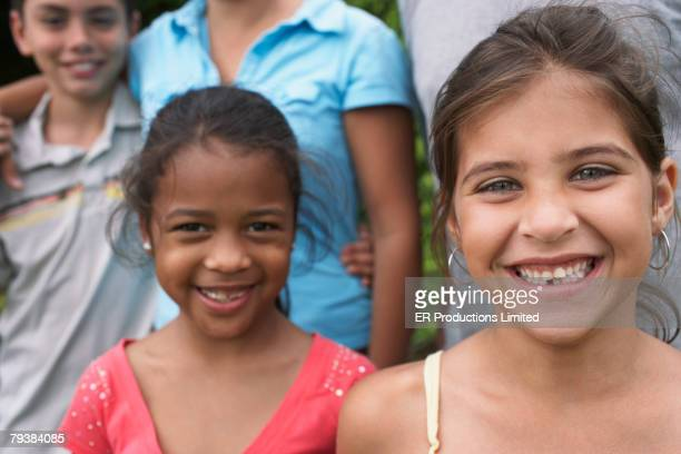 Close up of Mixed Race sisters smiling
