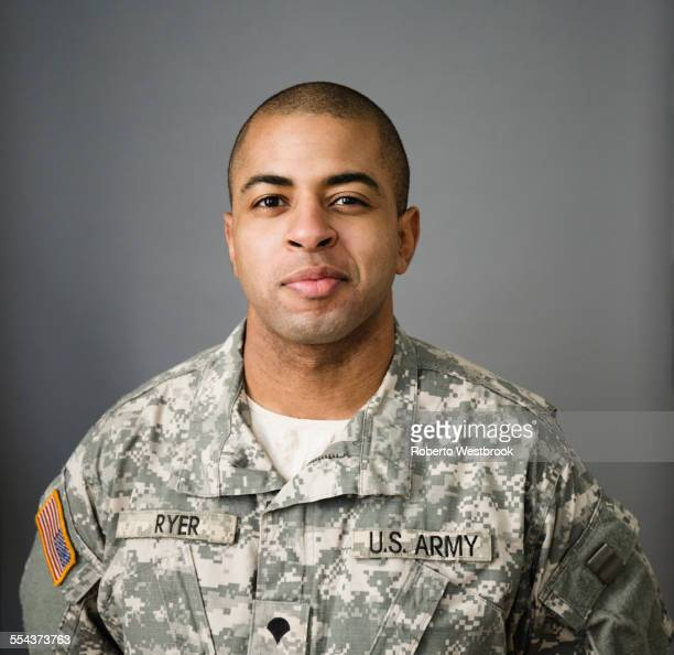 close up of mixed race soldier smiling - army soldier stock photos and pictures