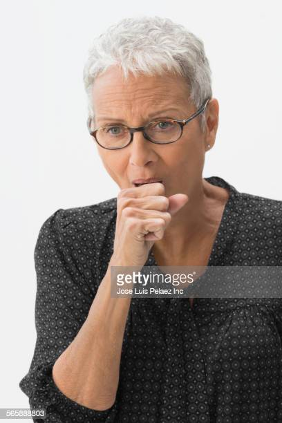 close up of mixed race woman coughing - cough stock photos and pictures