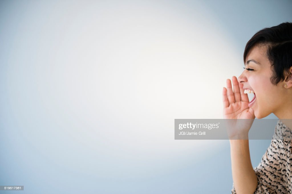 Close up of mixed race woman shouting : Stock Photo