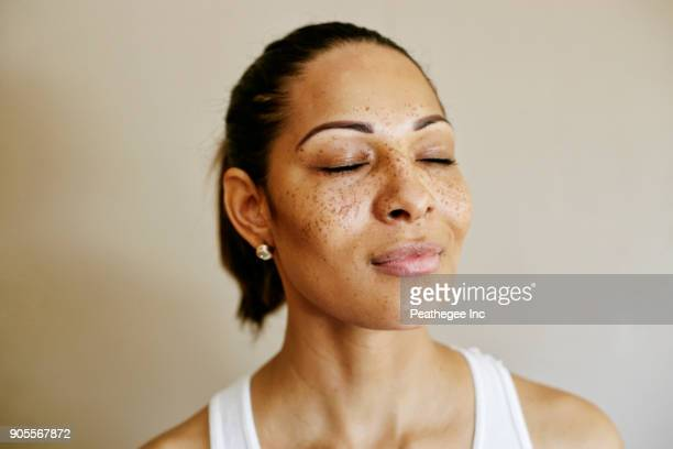 close up of mixed race woman with eyes closed - eyes closed stock pictures, royalty-free photos & images