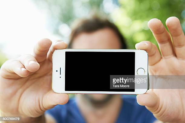 close up of mobile screen being held by man