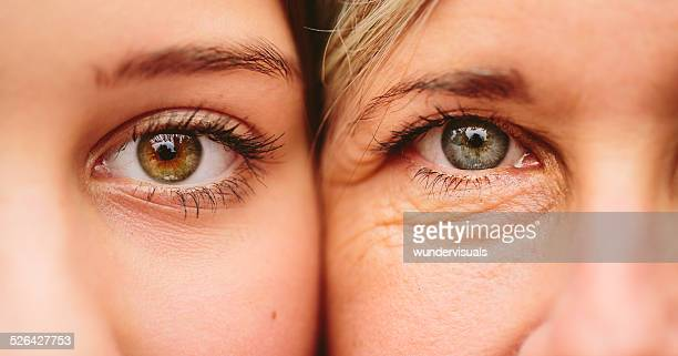 close up of mother and daughter faces together - human skin stock pictures, royalty-free photos & images
