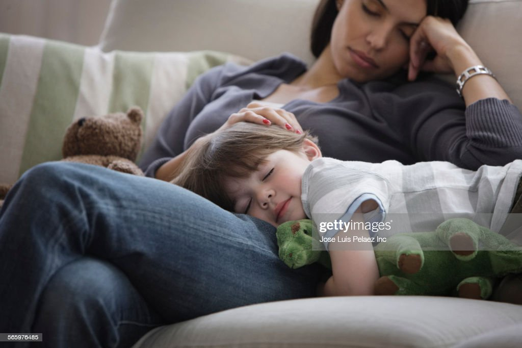 Close up of mother and son napping on sofa : Foto de stock