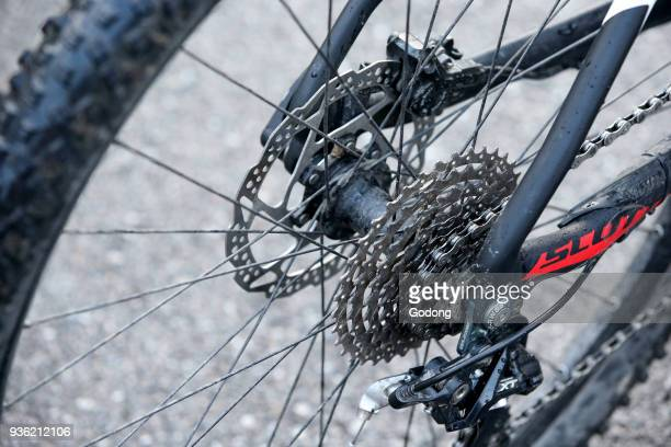 Close up of moutain bike chain and gears. France.