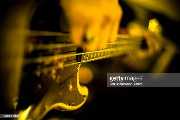 Close up of musician playing guitar
