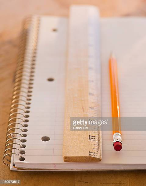 Close up of notebook, ruler and pencil, studio shot
