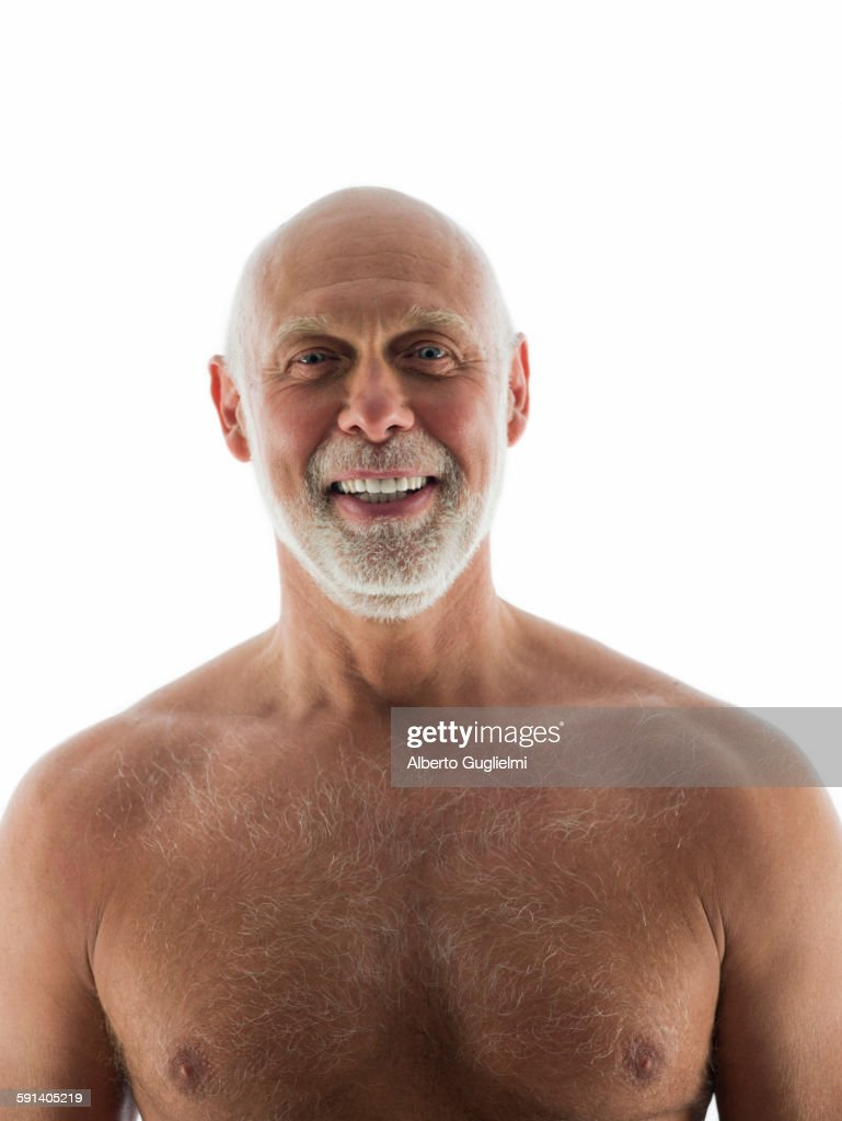Close Up Of Nude Older Man Smiling Stock Photo