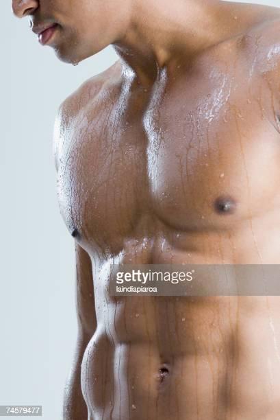 close up of nude, wet african man - ragazzi fighi nudi foto e immagini stock
