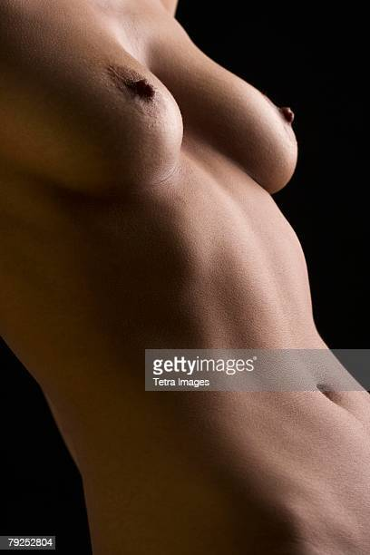 Close up of nude woman?s torso
