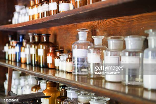 close up of old glass bottles for medicine - 医療とヘルスケア ストックフォトと画像