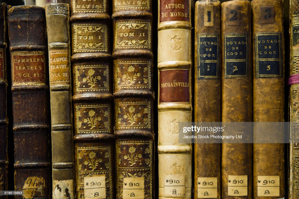Close up of old leather bound books in library : Stock Photo