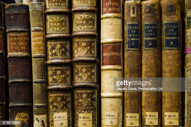 close up of old leather bound books in library - history stock-fotos und bilder