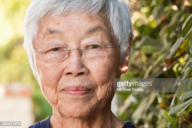 Close up of older Asian woman smiling