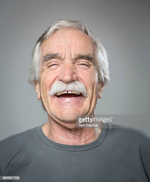 Close up of older Caucasian man laughing