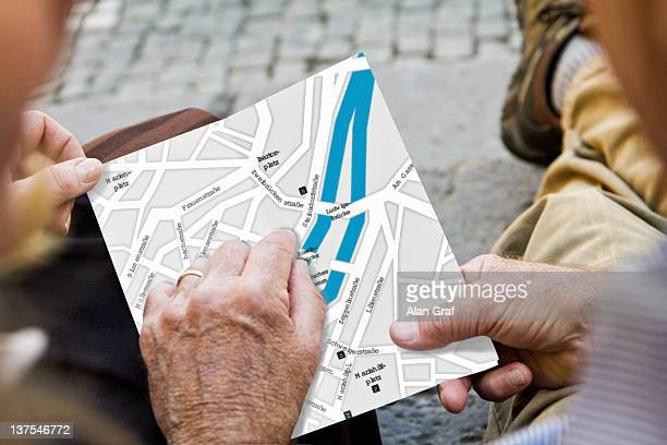 Close up of older couple with city map
