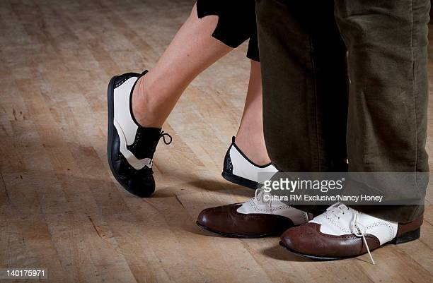 Close up of older couples dancing shoes