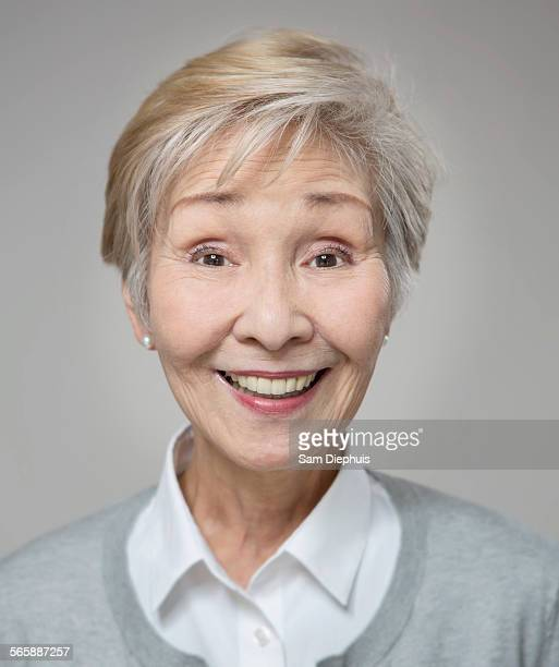 Close up of older Japanese woman smiling