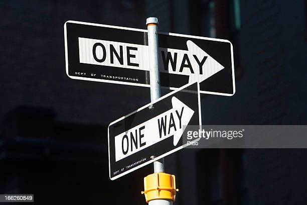 Close up of one way signs on street