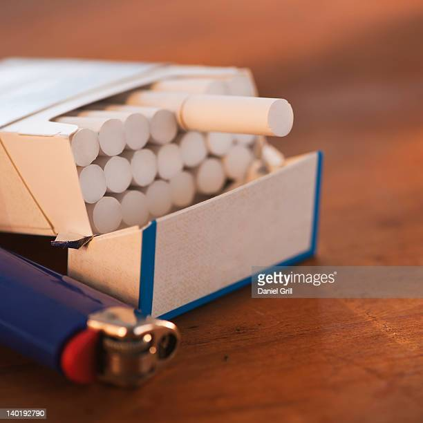 close up of open cigarette pack and lighter - cigarette pack stock pictures, royalty-free photos & images